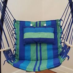Blue Padded Hammock Chair With Wooden Arm Rests And Pillow With Stand