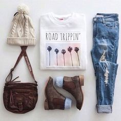   White Casual Graphic Tee   Distressed Light Washed Denim Jeans   Worn in Brown Leather Chelsea Boots   Brown Faux Leather Bag   Creme Knit Beanie  