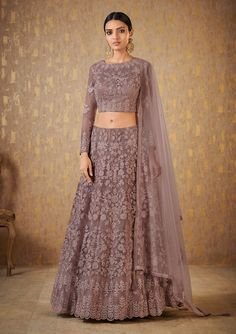 Look ravishing as you don this atypical mauve designer lehenga choli set featuring self color resham accentuation all over the set with stone detailing for a subtle yet blingy appeal! This lehenga choli set is accompanied with matching net dupatta. Indian Gowns Dresses, Indian Fashion Dresses, Indian Designer Outfits, Bridal Dresses, Choli Dress, Lehenga Choli, Net Lehenga, Floral Lehenga, Lehenga Designs Latest