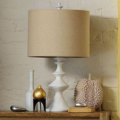 lamp for family room.  I like the color of shade w/ white base.  Like shape of base, not sure about rough finish.