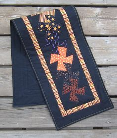 Halloween Twist Table Runner or Table Topper Black with Bright Colors Size: 39 x 11 Made of a variety of Halloween fabrics, I used the