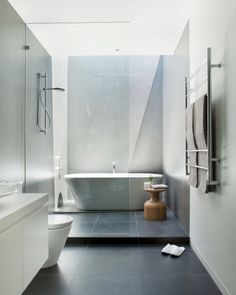 When designing a bathroom, finding the right balance between your need for plumbing, storage, mirrors, lighting and other fixtures with your desire for space can be quite the challenge. If space is limited, configuring all the essential pieces to fit cohesively might feel like you're putting together a giant puzzle.  Visit the blog for 5 design tips that will visually expand your small bathroom! Bathroom Floor Tiles, Laundry In Bathroom, Bathroom Layout, Modern Bathroom Design, Bathroom Interior Design, Bathroom Ideas, Bathroom Designs, Basement Bathroom, Bathroom Small