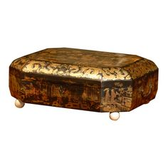 19th century Chinoiserie box with ivory feet and brass handles
