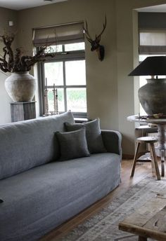 muted gray + brown tones for a quiet + calm living room