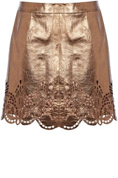 As seen in InStyle, this leather mini skirt has cut out detailing to the bottom and zips at the back.