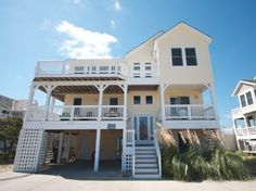 'GR8 Escape' is an 8 bedroom vacation rental home located in Nags Head, Nc. This pet friendly Nags Head home fronts the beach road and features a 14' x 28' private pool, hot tub and whirlpool tub.  Managed by Village Realty.  Property I.D. is JR27