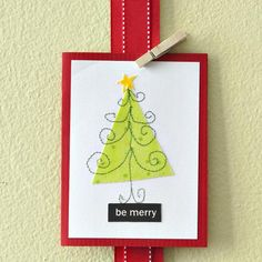 Decorate a Christmas tree with seasonal embellishments and a bright star on top for the perfect holiday greeting card. A cheerful printed message makes each card easy to personalize.