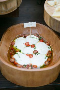 Burrata soaked in olive oil with tomatoes | Event Planning + Floral Design: Florabella - florabellastudios.com | Photography: Adriana Klas Photography - www.adrianaklasphotography.com/  Read More: http://www.stylemepretty.com/california-weddings/2014/05/30/elegant-al-fresco-wedding-at-home/