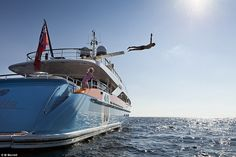 Service onboard a yacht has to go beyond that of a five-star hotel. Above, guests leap off...