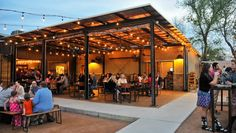 Best Austin Bars for Happy Hour | Contigo is a great spot for drinks after work in Austin. With a cool and rustic ambiance, it's a great place to spend a warm Austin night.