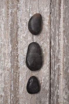 Zen Massage Stones on Rustic Wood.  Age and Serenity. Stock Photo