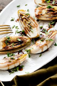 """Searing the endives so they retain some crispness, then topping them with balsamic butter, gives this dish, adapted from the cookbook """"Eat in My Kitchen"""" by Meike Peters, its panache. Because it's hard to make less balsamic butter than is called for, you wind up with enough for about a dozen endives, not just three; the endives portion of the recipe can be easily expanded to match, making this a great dish for entertaining. (Photo: Rikki Snyder for NYT)"""