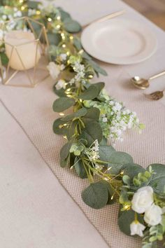 garland of flowers Flower runner:Eucalyptus runner is made with rich ranunculus asiaticus,rose,babysbreath and berry combined with a Eucalyptus garland. The battery powered led stri Greenery Garland, Light Garland, Flower Garlands, Flower Lights, Diy Garland, Wedding Table Centerpieces, Centerpiece Ideas, Wedding Table Runners, Quinceanera Centerpieces
