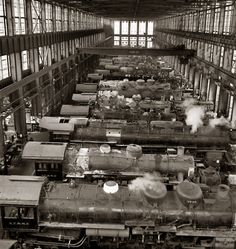 """March 1943. """"San Bernardino, California. A general view in the Atchison, Topeka, and Santa Fe Railroad locomotive shops."""" Medium-format nitrate negative by Jack Delano for the Farm Security Administration"""