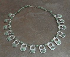 Pop top necklace by Tammy Easterling Soda Tab Crafts, Can Tab Crafts, Bottle Cap Crafts, Pop Top Crafts, Loom Band Patterns, Soda Can Tabs, Monster Crafts, Aluminum Crafts, Pop Tabs