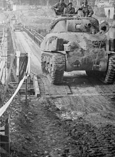 """AUG 28 1944 Over the Seine and """"push on"""" Sherman tanks crossing a Bailey bridge over the Seine at Vernon, 28 August 1944."""