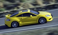 Mitsubishi Eclipse. My 14 y o does not care about cars like I do. I want this, she wants a boring old pickup truck.