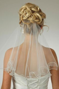 If I have a veil, just a short one. The way this one is put into the hair is cool though
