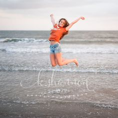 Fun senior portrait idea! T-shirt of her college, jumping for joy in the waves : ) Photo by K. Shannon Creative in League City, Texas.