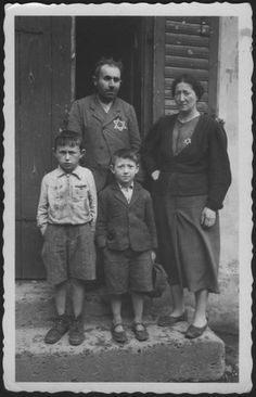 Wloclawek, Poland, Family members wearing the Jewish badge.  Belongs to collection: Yad Vashem Photo Archive