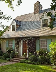 House Beautiful - home exteriors - cottage home, cottage home ideas, turquoise shutters, turquoise blue shutters,  Bee Cottage - Whimsical c...
