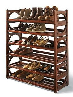 Handsomely store and organize your shoes on the Heritage Stacking Shoe Rack; made from solid mapa wood and graced with a rich mahogany finish.