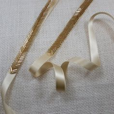 Gold bugle beads are used to create a delicate chevron style trim. The gold color is striking and will set off your dress to perfection! -
