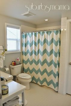 Light blue and white chevron pattern shower curtain in a white bathroom... Trending in Bathroom Decor: Colorful Chevron Patterns from Bathroom Bliss by Rotator Rod