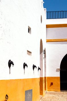 Colour block wall at the Plaza de Toros de La Maestranza in Seville, Spain @sevillaciudad @lonelyplanetes @tourisminspain | Bold Bliss