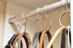 Need a cheap and simple way to organize all your purses in your closet? Use shower curtain rings! The shower rings roll easily over the clothing rod and the larger circular clamps hold the bags without twisting their handles. Hanging your bags will help to clear up a few shelves as well as make them visible and easily accessible!