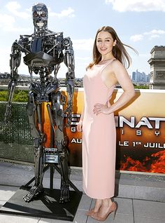 Emilia Clarke wore a long, pale pink dress at a photocall for Terminator Genisys in Paris.
