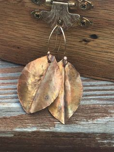 Fold form Copper Leaf earrings by Soul Sisters Designs~ Handcrafted earrings available in two different finishes!  Pictured above is our golden heat patina version, also available in a burnt copper finish.