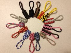 Paracord scraps turned into colorful and very durable zipper pulls and key fobs.  Easy DIY craft - 5 min. or less! Use on coats, back packs, gym bags, luggage, etc.  Our daughter even put one on her water bottle top which has gone through the dishwasher countless times!  Video tutorial coming soon to www.spiritbracelets101.com