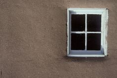 Window and adobe wall,  Trigg House, Nambe, New Mexico ©michael freeman