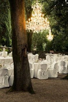 Forest Wedding With Fresh White Linen And Oversized Chandeliers