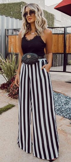 trendy outfit / black top + bag + stripped wide pants