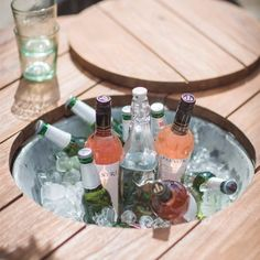 Outdoor Table in Reclaimed Teak with Drinks Holder. Modish Living. Garden table with built in ice bucket.