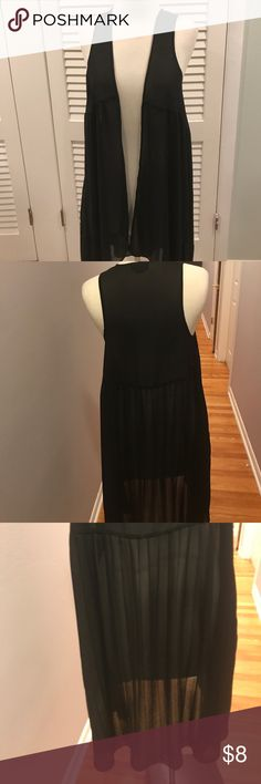 SHEER CHIFFON LIKE SLEEVELESS KIMONO/ vest Pictures do not do justice to this sheer black kimono like long vest with a pleated back. Looks great over tee and worn with skinny jeans or leggings . Tall boots or booties. Because the pictures need you to use your imagination- I've priced it to boost your confidence in this adorable David and young garment david and young Tops