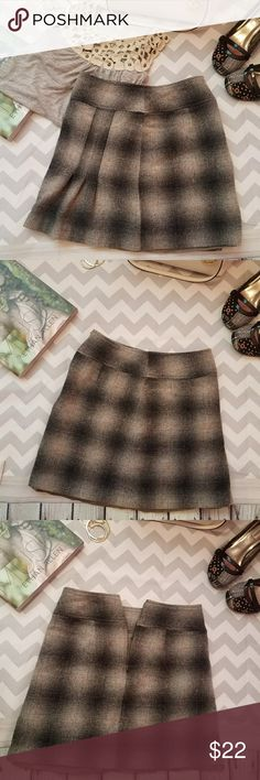Ann Taylor wool gray mini plaid pleated skirt Ann Taylor wool gray mini plaid pleated skirt Super cute and sexy So Warm, Fall must have👌 With you fav boots👢 It says Size 4 but it fits Xsmall! 13 inches waist across  15.5 inches length  80% wool❤  Linning is longer than the shell while laying flat Pre-loved condition No stains or flaws. Ann Taylor Skirts Mini