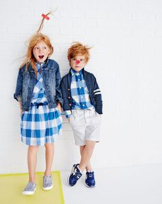 J.Crew girls' washed denim jacket, large gingham top, large gingham pull-on skirt and slide sneakers in glitter. J.Crew boys' shawl-collar varsity cardigan sweater, Secret Wash shirt in large gingham, Stanton short in garment-dyed chino and ASICS® Gel-Lyte™ sneakers.