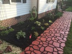 """QUIKRETE WalkMaker Country Stone Pattern Concrete Mold: """"We did the sidewalk 2 molds wide b/c we liked the wider look, mixed in red quikrete coloring. Used Black Beauty coal slag & sure bond 1300 sealer in between cobblestones b/c we could only find tan polymeric sand."""""""