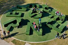 Typographic garden commissioned by the Thij College in Oldenzaal. Nine objects covered in artificial grass are used as outdoor furniture for the school. The usually flat material of artificial turf achieves three-dimensionality through the oversized letters that spread across a 20-meter circle. The Nine huge letters form both the seating area itself and the name of the project, offering a range of playful lounging options where youngsters can relax and socialize.
