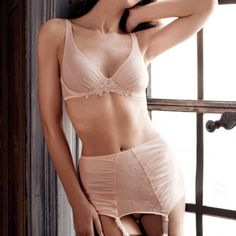 Pastel pink vintage silhouette with this retro suspender belt by Simone Perele