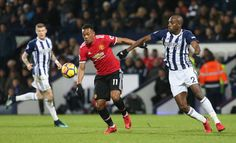Anthony Martial of Manchester United in action with Allan Nyom of West Bromwich Albion during the Premier League match between West Bromwich Albion...