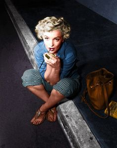 Well, it's Marilyn! But doesn't it look like it might have been taken this afternoon? Look, an amazing bag, a great book, cute wee trousers, great hair ...