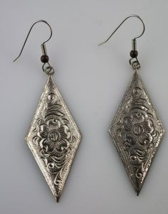 I like the antique silver  and shape of these earrings.