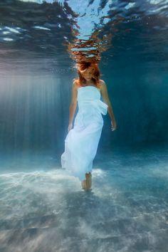 Her red locks in the water look STUNNING.