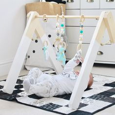 Current 25% offer not valid on baby gyms.  Please kindly note all gyms are handmade to order - if in doubt please send a message to discuss. Orders are posted out within 6 weeks of being received, if you need yours sooner please let me know BEFORE ordering and I will do my very best to accommodate.  Tired of gaudy, plastic baby gyms then this is the gym for you. Its tough finding baby toys which fit in with a stylish home. This gym not only looks beautiful when in use but also folds so can…