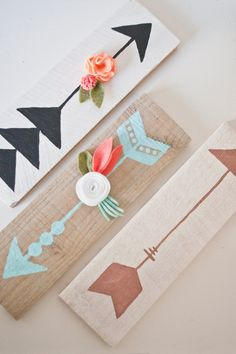 A beautifully hand painted arrow on stained reclaimed wood. Customize the colors to fit with your nursery or home. Arrows may also come with handmade felt flowers to enhance any space. An arrow wood sign is perfect for any home, especially when paired with any of the Southwest Charm decor. Hanging: Each wood sign has a saw-tooth hanger connected to the back. Dimensions: Length: 12 Height: 3.5 Width: 1/2 an inch Colors: *Stain- Choose between sun-bleached grey, golden maple, dark...