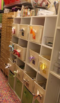 Color bins hold scrapbooking supplies. Love the ribbon tied on the handle to tell you at a glance the color the bin contains. Stacy Julian.